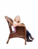 Маленькая девочка сидя на стуле стоковая фотография rf