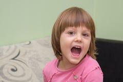 Маленькая девочка смотря с выражением удара Стоковая Фотография