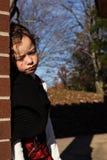 Маленькая девочка смотря унылый и изолированный Стоковые Изображения