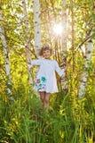 Маленькая девочка среди берез Стоковые Фотографии RF