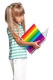 Маленькая девочка с книгами тренировки Стоковое Изображение RF