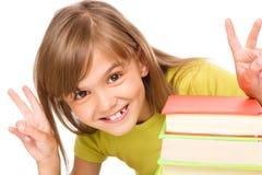 Маленькая девочка с кучей книг стоковые фотографии rf