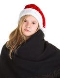 Маленькая девочка с накидкой и красная зима покрывают представлять положения Стоковое Изображение