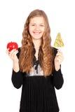 Маленькая девочка с одним леденцом на палочке и одним яблоком Стоковое Фото