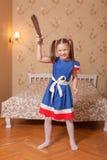 Маленькая девочка с поясом в руке стоковое изображение