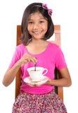 Маленькая девочка с чаем и печеньем III Стоковые Изображения RF