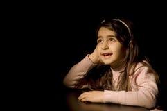 Маленькая девочка с черной предпосылкой Стоковые Изображения RF