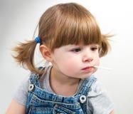 Маленькая девочка с lollipop Стоковое Фото