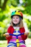 Маленькая девочка трицикл Стоковая Фотография