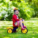 Маленькая девочка трицикл Стоковая Фотография RF