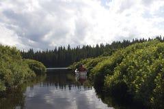 Маленькая лодка в воде Стоковая Фотография