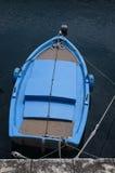 Маленькая лодка на стыковке Стоковое фото RF