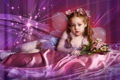 Маленькая фея с цветками Стоковые Фото