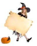 Маленькая шаловливая ведьма держа знак Стоковая Фотография