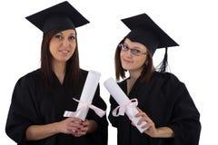 Маленькие девочки в хламиде студента с дипломом Стоковые Изображения