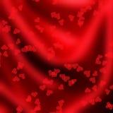 Маленькие красные Харты на silk текстуре Стоковые Фотографии RF