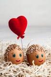 Маленькие люди от яичек и красного сердца Стоковые Фото