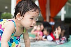 Маленький азиатский малыш с костюмом заплывания Стоковая Фотография RF