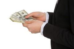 Маленький бизнесмен подсчитывая деньги. Стоковое Изображение