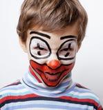 Маленький милый мальчик с facepaint любит клоун Стоковое Изображение RF