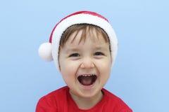 Маленький ребенок одетый как смеяться над Санта Клауса стоковые фотографии rf