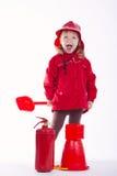 Маленький серьезный пожарный на белой предпосылке Стоковое Изображение