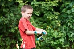 Маленький лучник с луком и стрелы Стоковые Фотографии RF