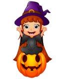Маленький шарж ведьмы сидя на тыкве Стоковая Фотография RF