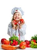 Маленький шеф-повар держа томат стоковое изображение