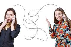 2 маленькой девочки говоря сотовыми телефонами Стоковое фото RF