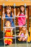4 маленькой девочки играя на спортивной площадке Стоковое фото RF