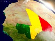 Мали с флагом в восходящем солнце Стоковая Фотография