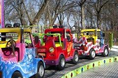 Малые автомобили в парке потехи Стоковая Фотография