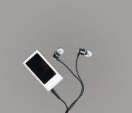 Малые аудиоплейер MP3 и earbuds Стоковое Изображение