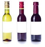 Малые бутылки с белой, белой предпосылкой Стоковые Изображения RF