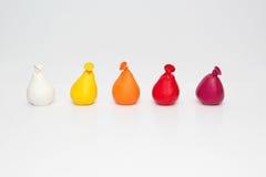 Малые воздушные шары ступенчатости цвета на белой предпосылке Стоковое Изображение RF