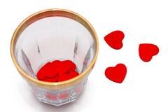 Малые деревянные сердца в и рядом с стекле Стоковое Изображение RF