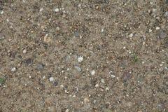 Малые камешки в предпосылке грязи Стоковая Фотография RF