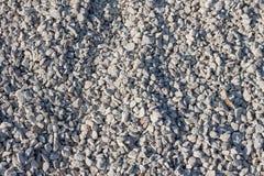 Малые камни гравия на строительной площадке стоковые изображения