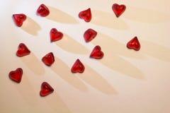 Малые красные сердца на белой предпосылке Стоковое фото RF