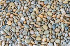 Малые ровные waterworn черные камешки или камни для оформления пользы и Стоковые Изображения RF