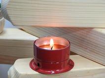Малые свечи на досках Стоковое Фото