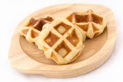 Малые waffles на деревянном блюде Стоковое фото RF