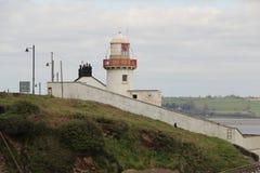 Малый белый маяк в Ирландии Стоковые Изображения RF
