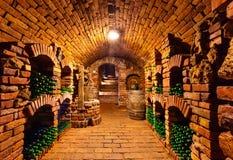 Малый винный погреб с бутылками и бочонком стоковое изображение