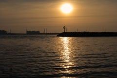 Малый маяк на заходе солнца Стоковое Изображение