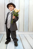 Малый мальчик в костюме Стоковое Изображение