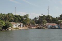 Малый порт на банке реки Preguiça стоковая фотография rf