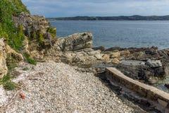 Малый пляж в острове Ammouliani, Athos, Chalkidiki, Греции Стоковые Фотографии RF