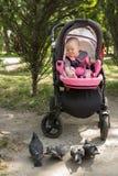 Малый ребенок сидя в pram Стоковое фото RF